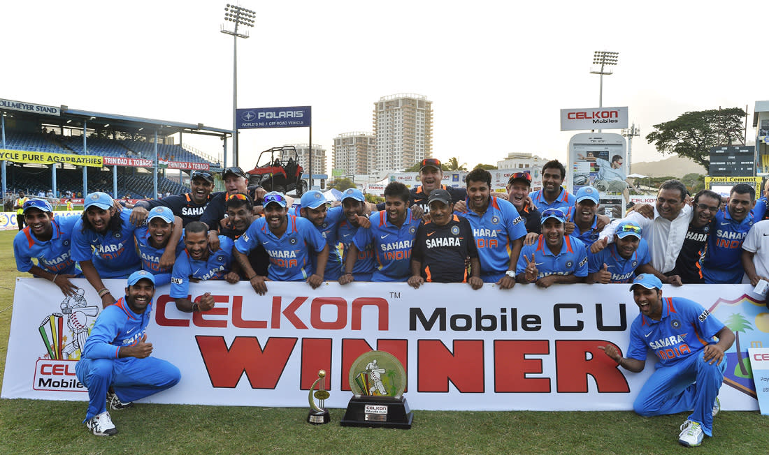 Indian cricket team celebrate with their winning trophy at the end of the final match of the Tri-Nation series between India and Sri Lanka at the Queen's Park Oval stadium in Port of Spain on July 11, 2013. India defeated Sri Lanka by 1 wicket to win the series. AFP PHOTO/Jewel Samad