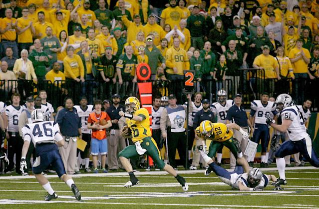 North Dakota State quarterback Brock Jensen (10) runs in the open field against New Hampshire defenders during the first half of an NCAA Football Championship Subdivision semifinal on Friday, Dec. 20, 2013, at the Fargodome in Fargo, N.D. (AP Photo/Bruce Crummy)