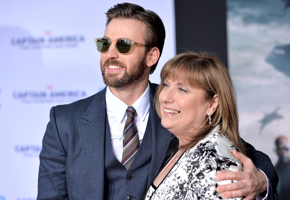 "HOLLYWOOD, CA - MARCH 13:  Actor Chris Evans (L) and Lisa Evans attend Marvel's ""Captain America: The Winter Soldier"" premiere at the El Capitan Theatre on March 13, 2014 in Hollywood, California.  (Photo by Alberto E. Rodriguez/Getty Images for Disney)"