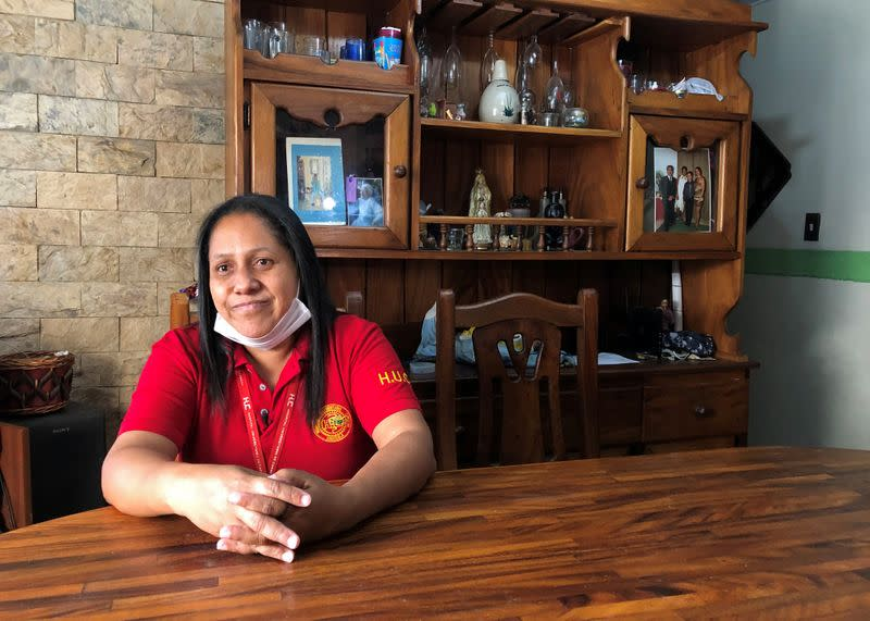 Hospital security guard Diaz talks at her home in Caracas