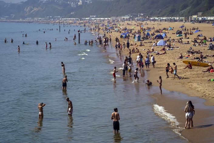 People enjoy the warm weather on Bournemouth Beach in Dorset. Picture date: Monday September 6, 2021.