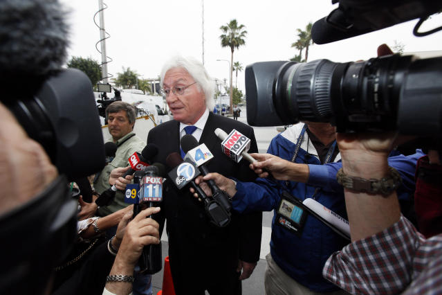 Former Michael Jackson's attorney Thomas Mesereau talks to reporters as he arrives at a courthouse for Katherine Jackson's lawsuit against concert giant AEG Live in Los Angeles, Monday, April 29, 2013. Mesereau is expected to testify during the trial. (AP Photo/Nick Ut)