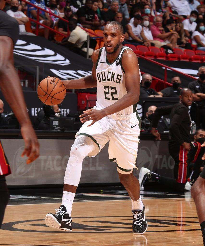 MIAMI, FL – MAY 29: Khris Middleton #22 of the Milwaukee Bucks drives to the basket against the Miami Heat during Round 1, Game 4 of the 2021 NBA Playoffs on May 29, 2021 at American Airlines Arena in Miami, Florida. NOTE TO USER: User expressly acknowledges and agrees that, by downloading and or using this Photograph, user is consenting to the terms and conditions of the Getty Images License Agreement. Mandatory Copyright Notice: Copyright 2021 NBAE (Photo by Issac Baldizon/NBAE via Getty Images)