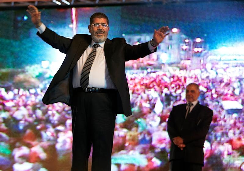 MUSLIM BROTHERHOOD WEAKER THAN EXPECTED: Mohammed Morsi, the Muslim Brotherhood's candidate, got the most votes and will have the lead going into the June 16-17 runoff. However, the Brotherhood's showing in general was weak compared to its domination of parliamentary elections last year, a sign of public disenchantment with the group. That said, Morsi will have a strong chance of winning the runoff. In this Sunday, May 20, 2012, photo, Morsi holds a rally in Cairo. (AP Photo/Fredrik Persson)