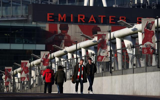 <p>Arsenal fans arrive at the Emirates for the second match of the day </p>