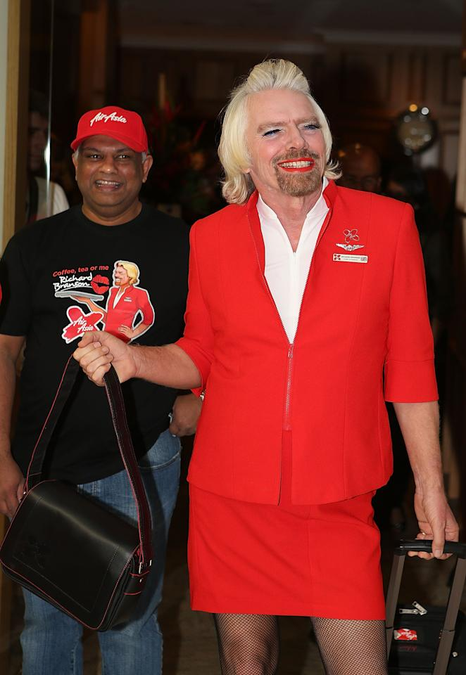 PERTH, AUSTRALIA - MAY 12:  Sir Richard Branson walks from a VIP lounge with Tony Fernandes prior to their flight to Kuala Lumpur at Perth International Airport on May 12, 2013 in Perth, Australia. Sir Richard Branson lost a friendly bet to AirAsia Group Chief Executive Officer Tony Fernandez after wagering on which of their Formula One racing teams would finish ahead of each other in their debut season of the 2010 Formula One Grand Prix in Abu Dhabi and that the loser would serve as a female flight attendant on board the winner's airline.  (Photo by Paul Kane/Getty Images)
