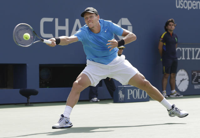 Czech Republic's Tomas Berdych returns a shot to Britain's Andy Murray during a semifinal match at the 2012 US Open tennis tournament, Saturday, Sept. 8, 2012, in New York. (AP Photo/Darron Cummings)