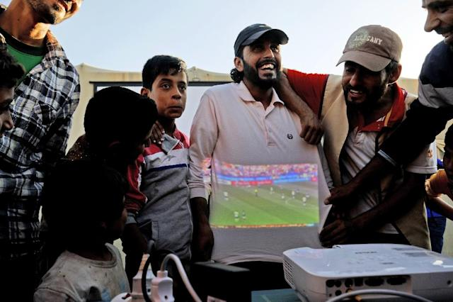 A local charity is screening all World Cup matches for free at the Ain Issa camp (AFP Photo/Delil SOULEIMAN)