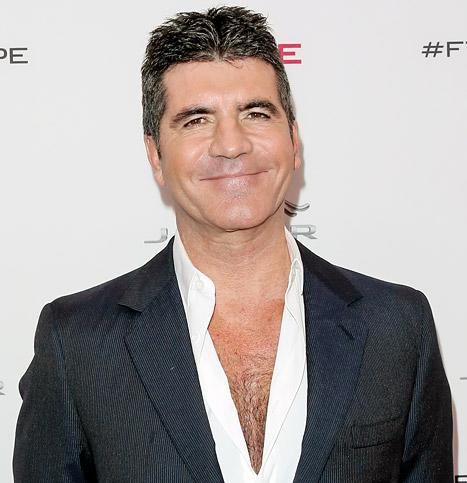 "Simon Cowell Gives First Interview Since Baby Eric's Birth, Says He ""Was Born to Be a Dad"""