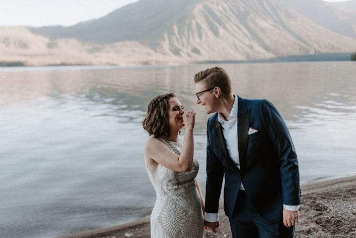 Amanda Taylor, left, and Christina Stewart of Lansing, Michigan wed at sunrise in Montana's Glacier National Park in July.