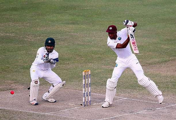 DUBAI, UNITED ARAB EMIRATES - OCTOBER 17: Roston Chase of West Indies bats during Day Five of the First Test between Pakistan and West Indies at Dubai International Cricket Ground on October 17, 2016 in Dubai, United Arab Emirates. (Photo by Francois Nel/Getty Images)