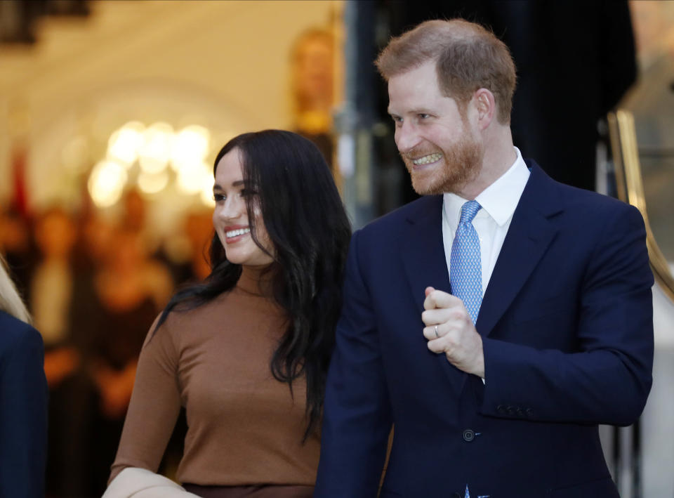 """FILE - In this Tuesday Jan. 7, 2020 file photo Britain's Prince Harry and Meghan, Duchess of Sussex leave after visiting Canada House in London after their recent stay in Canada. In a stunning declaration, Britain's Prince Harry and his wife, Meghan, said they are planning """"to step back"""" as senior members of the royal family and """"work to become financially independent."""" A statement issued by the couple Wednesday, Jan. 8, 2020 also said they intend to """"balance"""" their time between the U.K. and North America. (AP Photo/Frank Augstein, FILE)"""