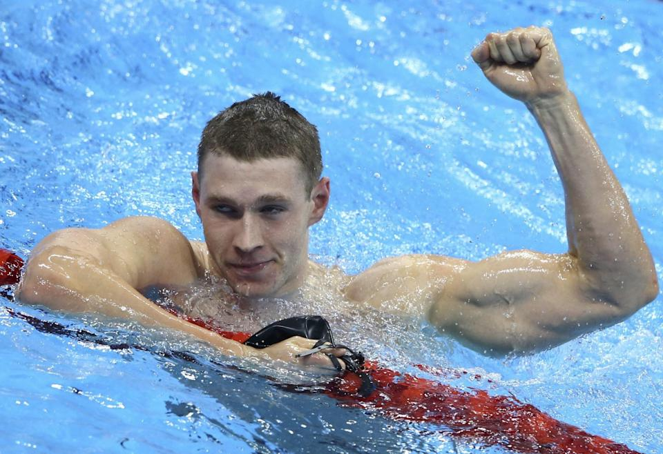 Ryan Murphy celebrates after winning the gold medal in the 100 backstroke. (Reuters)