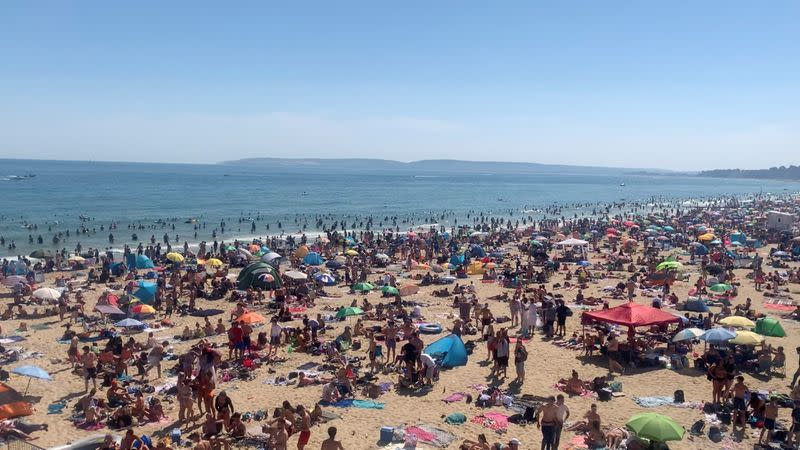 People enjoy the hot weather at the beach in Bournemouth