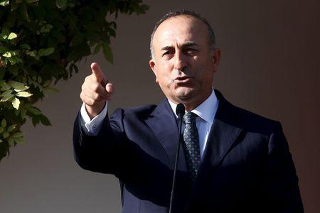 Turkey's Foreign Minister Mevlut Cavusoglu speaks to the media during a visit to northern Cyprus