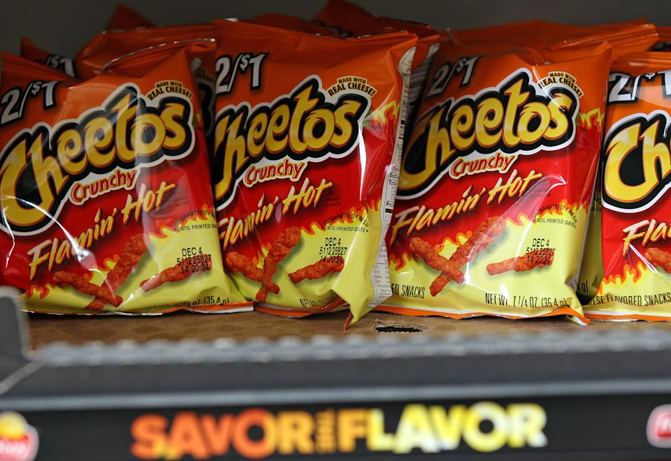 Bags of Cheetos Flamin' Hot Crunchy are displayed for sale at Touchdown Food Mart, September 27, 2012, in Chicago, Illinois. (John J. Kim/Chicago Tribune/Tribune News Service via Getty Images)