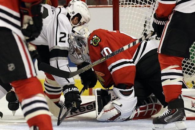 Chicago Blackhawks goalie Corey Crawford (50), right, saves a shot by Los Angeles Kings' Jarret Stoll (28) during the first period in Game 1 of the Western Conference finals in the NHL hockey Stanley Cup playoffs in Chicago on Sunday, May 18, 2014. (AP Photo/Nam Y. Huh)