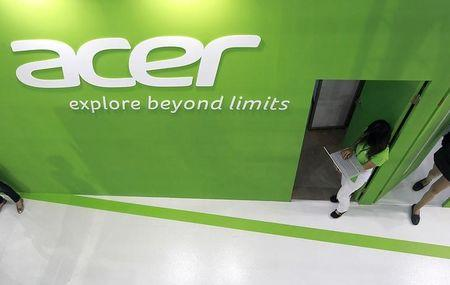 An employee uses an Acer laptop at the company's booth during the 2014 Computex exhibition at the TWTC Nangang exhibition hall in Taipei
