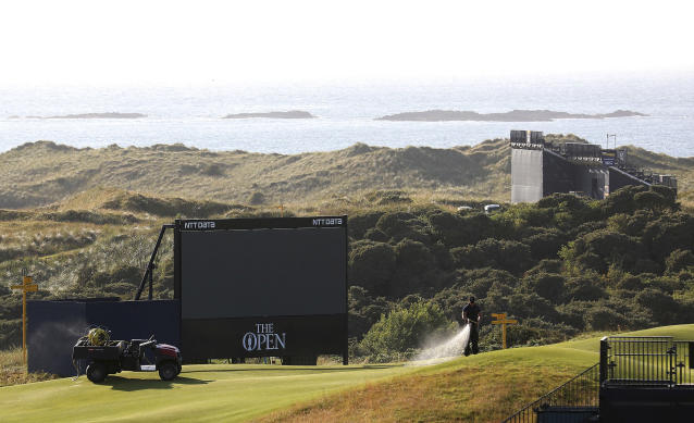 A member of the groundstaff waters the greens on the Dunluce Links course at Royal Portrush Golf Club, Northern Ireland, Saturday, July, 6th 2019. The Open Golf Championship will be played at Royal Portrush marking a historic return to Northern Ireland after it was last played there in 1951. (AP Photo/Peter Morrison)