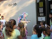 """<div class=""""caption-credit"""">Photo by: Queens Library</div><b>2008 Challenge: Read 4,000 books <br> Final Results: 4,303 books</b> <br> """"I dressed in all black and the kids sprayed me with silly string,"""" says Scatena. """"In the end, I looked like a Picasso painting."""""""