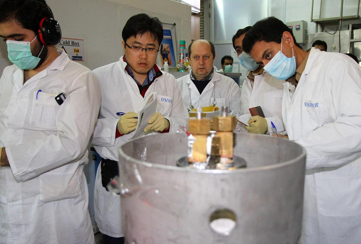 International Atomic Energy Agency inspectors and Iranian technicians at the nuclear power plant in Natanz, Iran, in January 2014. (Photo: Kazem Ghane/AFP/Getty Images)