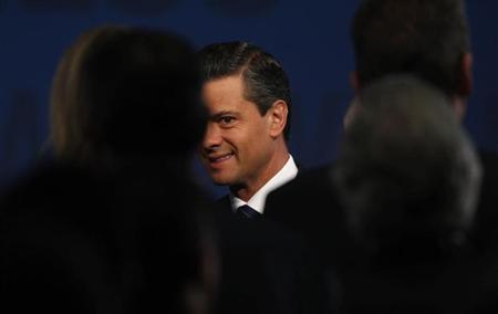 Mexico's President Pena Nieto arrives at The Economist's Mexico Summit 2013 in Mexico City