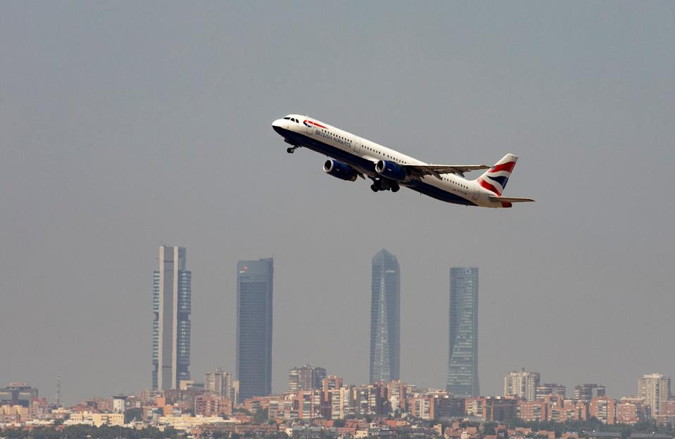 A British Airways Airbus A321-200 airplane takes off from the Adolfo Suarez Madrid-Barajas airport as seen from Paracuellos del Jarama, outside Madrid, Spain, August 8, 2018.  REUTERS/Paul Hanna