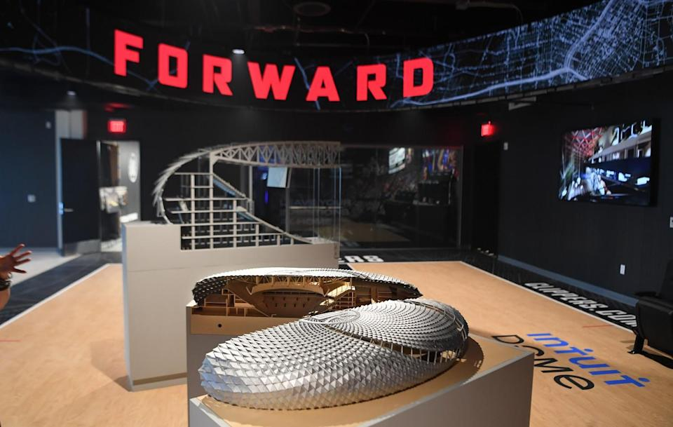 Models of the Clippers' Intuit Dome, including a cross-section showing the incline of one section of stands.