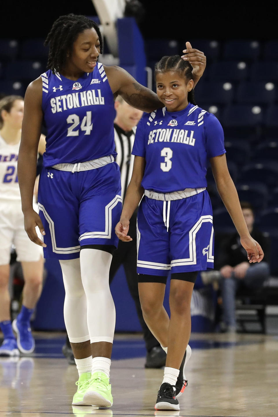 Seton Hall guard Lauren Park-Lane, right, is congratulated by forward Shadeen Samuels after scoring a basket during the first half of an NCAA college basketball game against DePaul in the Big East women's tournament semifinals, Sunday, March 8, 2020, in Chicago. (AP Photo/Nam Y. Huh)