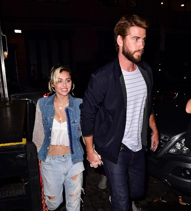 Reunited and it feels so good … Miley Cyrus and Liam Hemsworth stroll hand-in-hand. (Photo: Getty Images)