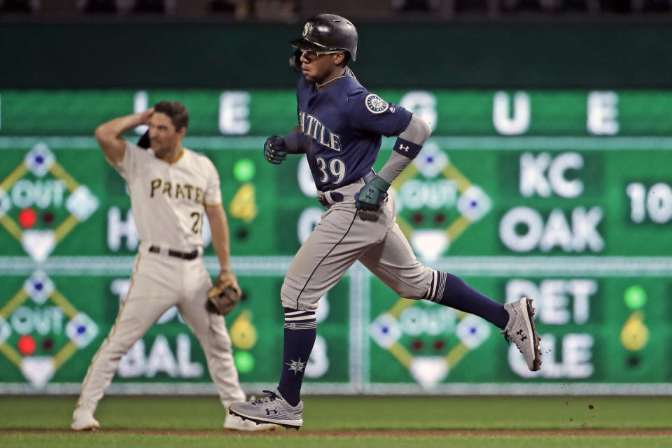 Seattle Mariners' Shed Long (39) rounds second base past Pittsburgh Pirates second baseman Adam Frazier after hitting a solo home run off Pirates relief pitcher Williams Jerez during the seventh inning of a baseball game in Pittsburgh, Tuesday, Sept. 17, 2019. (AP Photo/Gene J. Puskar)
