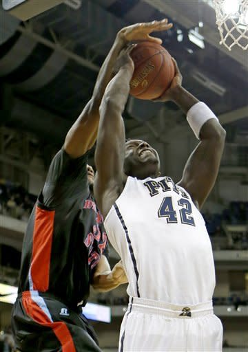 Delaware State's Marques Oliver, left, blocks a shot by Pittsburgh's Talib Zanna (42) in the first half of their NCAA college basketball game on Wednesday, Dec. 19, 2012, in Pittsburgh. (AP Photo/Keith Srakocic)