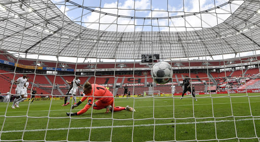 FILE - In this June 27, 2020, file photo, Mainz goalkeeper Florian Mueller receives the opening goal by Leverkusen's Kevin Volland during a German Bundesliga soccer match in Leverkusen, Germany. (AP Photo/Martin Meissner, Pool, File)