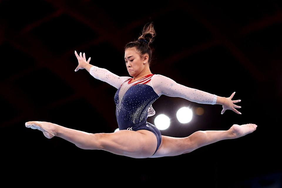<p>Sunisa Lee competes on balance beam during the women's all-around final. Lee took home the gold medal, making her the first Hmong-American to to make the U.S. Olympic team and win gold.</p>