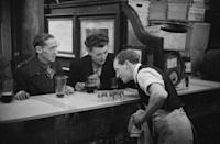 <p>Customers at the bar of one of the numerous pubs in the Gorbals area of Glasgow. The city in the United Kingdom is known for unique craft beer spots and cocktail bars.</p>