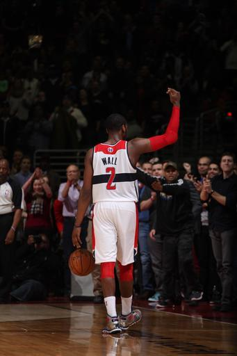 WASHINGTON, DC - MARCH 25: John Wall #2 of the Washington Wizards celebrates after the game against the Memphis Grizzlies at the Verizon Center on March 25, 2013 in Washington, DC. (Photo by Stephen Gosling/NBAE via Getty Images)