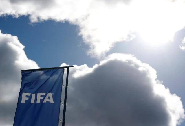 A FIFA flag flies in front of its headquarters in Zurich