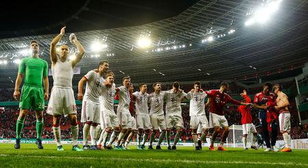 Bayern Munich players celebrate after the match. REUTERS/Wolfgang Rattay