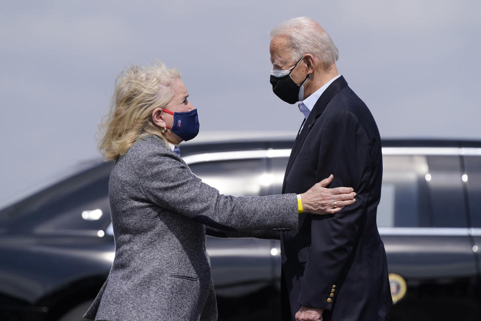 President Joe Biden speaks with Rep. Sylvia Garcia, D-Texas, after stepping off Air Force One at Ellington Field Joint Reserve Base in Houston, Friday, Feb. 26, 2021. (AP Photo/Patrick Semansky)