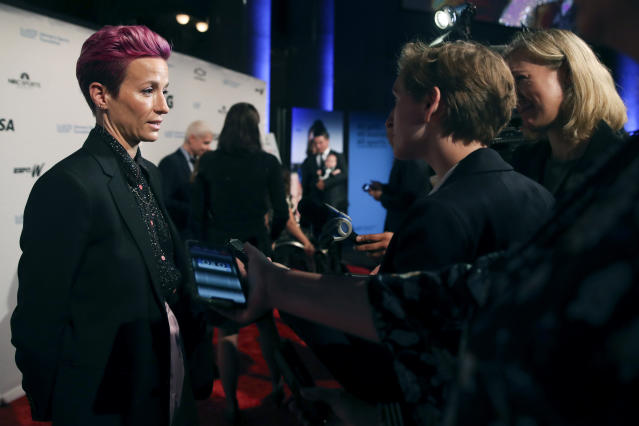 In this Wednesday, Oct. 16, 2019, photo, soccer star Megan Rapinoe talks to reporters on the red carpet of the Women's Sports Foundation's 40th annual Salute to Women in Sports in New York. Rapinoe, who was honored at the gala, won Sportswoman of the Year in the team category. She led the U.S. women's soccer team to victory at the World Cup in France and earned the FIFA Player of the Year award. (AP Photo/Mary Altaffer)