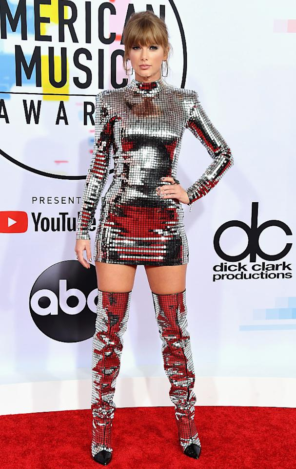"<p>Taylor Swift looked like she belonged at Studio 54 when she rocked a disco-ball-inspired Balmain dress, thigh-high boots, and — notably — a <a rel=""nofollow"" href=""https://www.yahoo.com/lifestyle/taylor-swift-fans-troll-kim-124900656.html"">snake</a> ring. Just one day after posting a controversial <a rel=""nofollow"" href=""https://www.yahoo.com/entertainment/taylor-swift-makes-public-political-statement-career-says-cannot-support-marsha-blackburn-003239061.html"">political message,</a> Swift walked into the show knowing that she was nominated for four awards and scheduled to open the show. Does she look at all nervous to you? (Photo: Steve Granitz/WireImage) </p>"