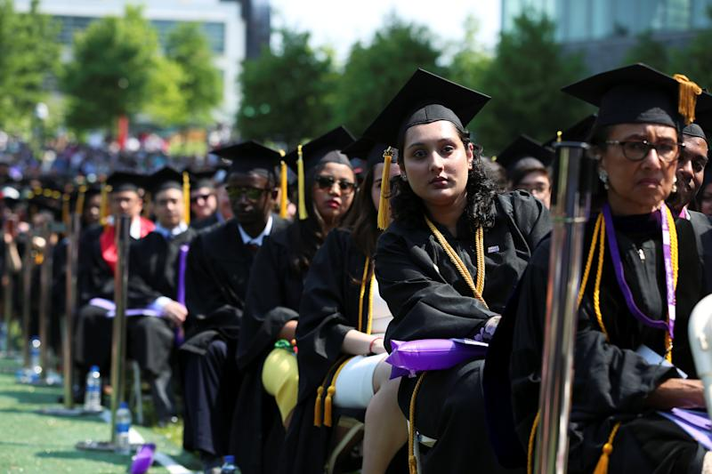 Graduates of The City College of New York sit in their seats at their commencement ceremony in Manhattan on May 31, 2019. REUTERS/Gabriela Bhaskar