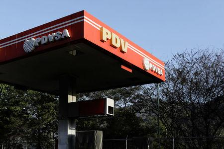 The corporate logo of the state oil company PDVSA is seen at a gas station in Caracas, Venezuela March 18, 2018.  REUTERS/Marco Bello