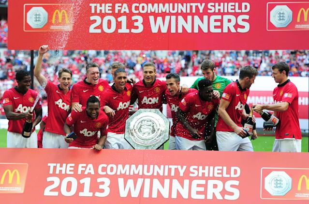 LONDON, ENGLAND - AUGUST 11: Nemanja Vidic of Manchester United (C) and team mates celebrate with the trophy after victory in the FA Community Shield match between Manchester United and Wigan Athletic at Wembley Stadium on August 11, 2013 in London, England. (Photo by Jamie McDonald/Getty Images)