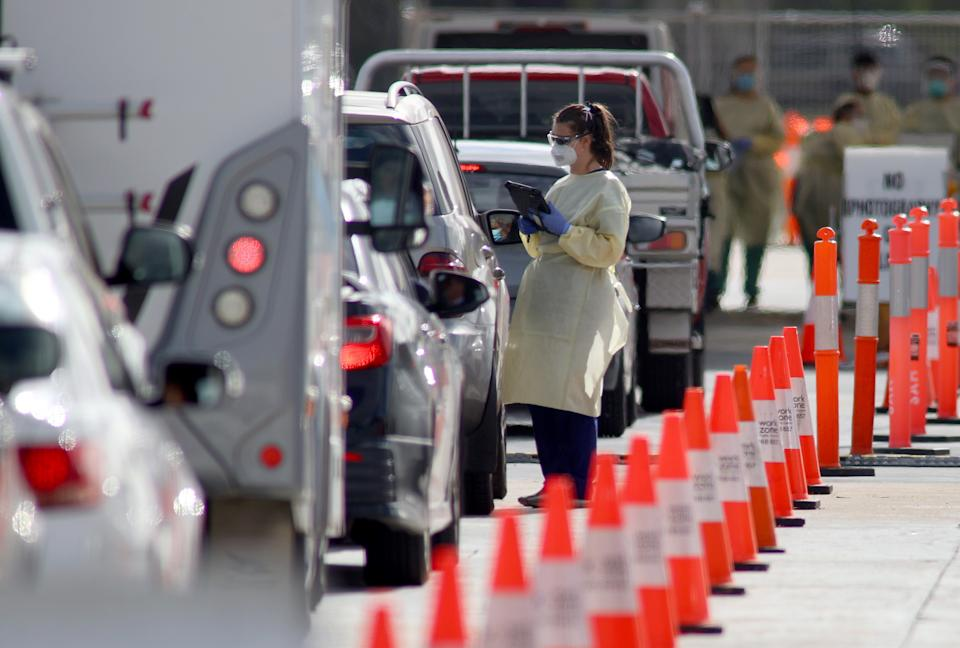 People waiting in their cars at the Covid-19 testing facility. Source: AAP