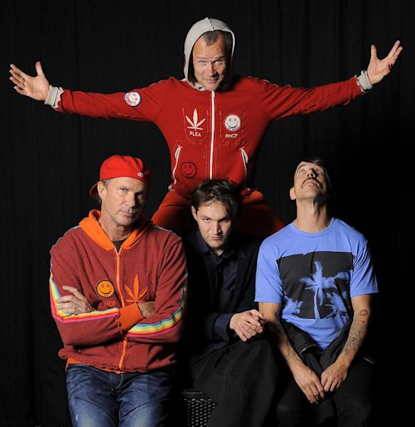 In this March 16, 2012 photo, members of the Red Hot Chili Peppers, clockwise from top, bassist Flea, singer Anthony Kiedis, guitarist Josh Klinghoffer and drummer Chad Smith pose for a portrait in the Hollywood section of Los Angeles. The group will be inducted into the Rock and Rock Hall of Fame on Saturday, April 14. (AP Photo/Chris Pizzello)