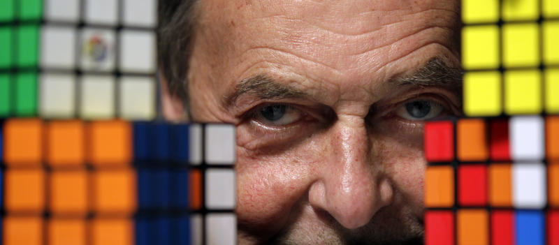 Erno Rubik, the inventor of the Rubik's Cube, poses for The Associated Press with cubes at Liberty Science Center, Wednesday, April 25, 2012, in Jersey City, N.J. The center will have an exhibit on the toys and will include a cube made with diamonds that is worth 2.5 million dollars. (AP Photo/Julio Cortez)
