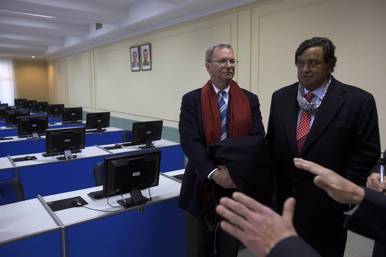 Executive Chairman of Google, Eric Schmidt, left, and former New Mexico governor Bill Richardson tour a computer lab at Kim Il Sung University in Pyongyang, North Korea.
