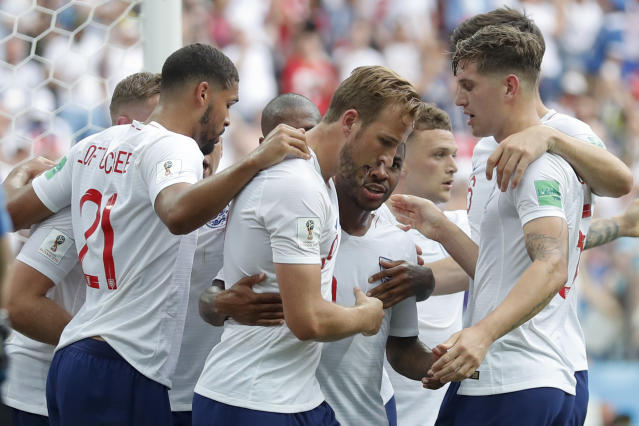 England players celebrate after their teammate Harry Kane, center, scored their side's fith goal during the group G match between England and Panama at the 2018 soccer World Cup at the Nizhny Novgorod Stadium in Nizhny Novgorod , Russia, Sunday, June 24, 2018. (AP Photo/Antonio Calanni)