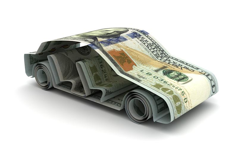 Hundred dollar bills arranged to form the shape of a car.